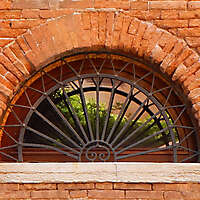 rounded window with cage