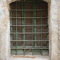 window medieval with rusty cage old paint