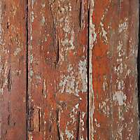 old planks with scraped red paint