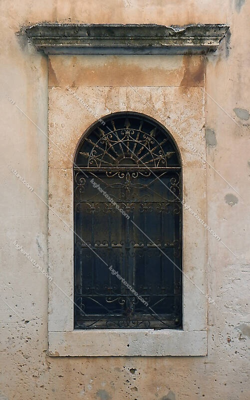 old medieval window with grate 9