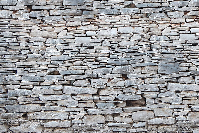 Irregular rock bricks wall