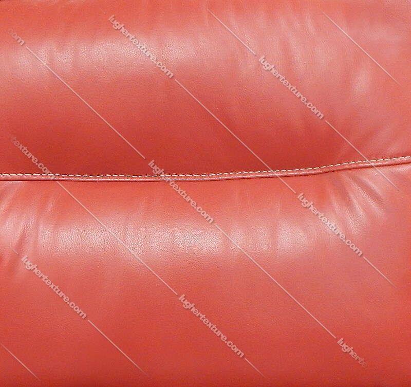 red leather backrest couch with sewings