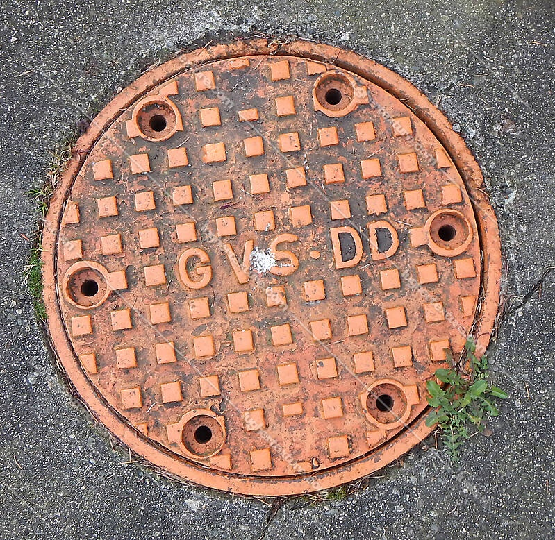 manhole cover orange big