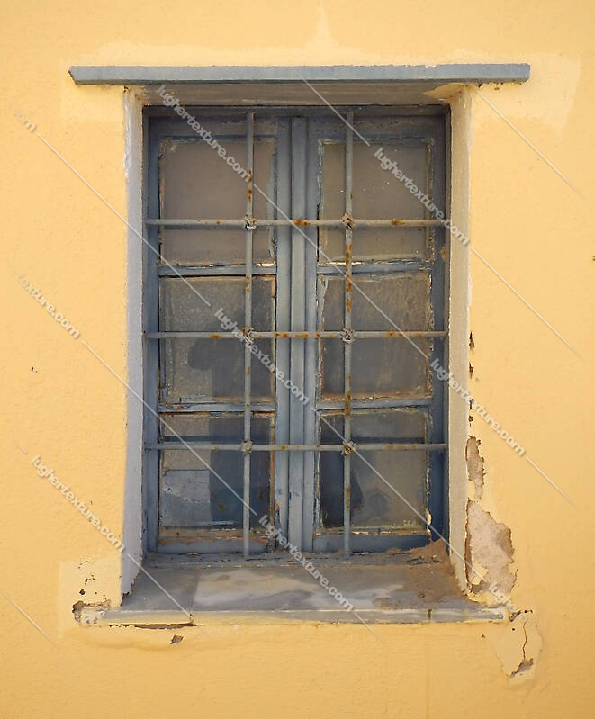 old barred window with stone frame 13