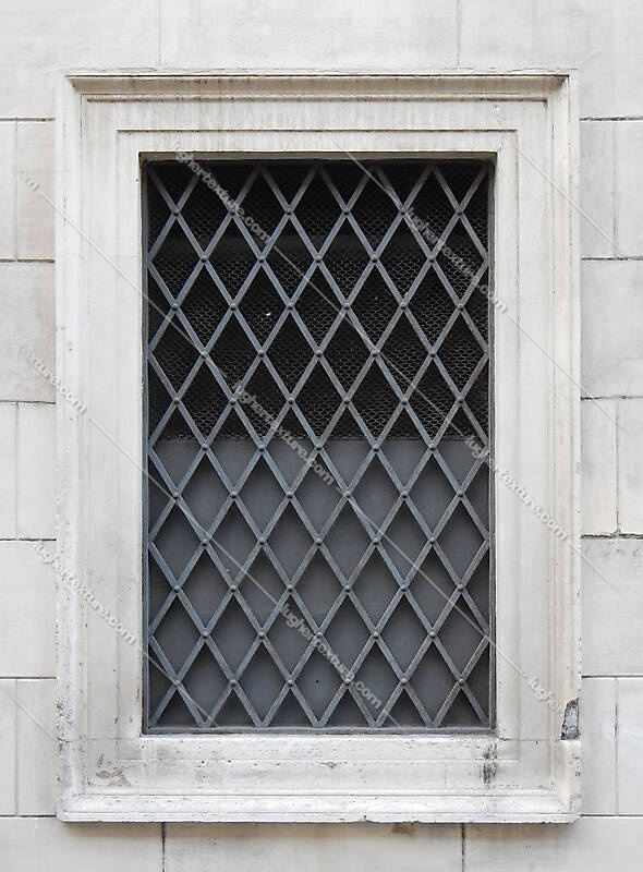 old barred window with stone frame 17