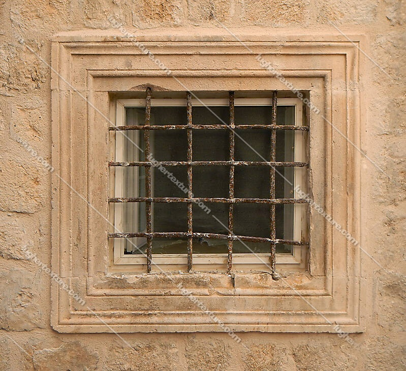 old barred window with stone frame 4